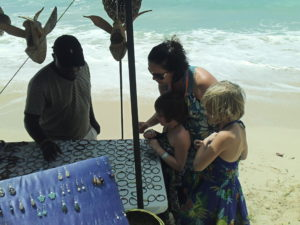jewelry shopping on Barbados beach during family vacation